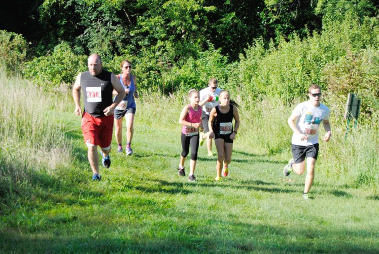 T-R FILE PHOTO Runners and walkers of all ages participated in last year's Ethan's Tractor Run 5k.