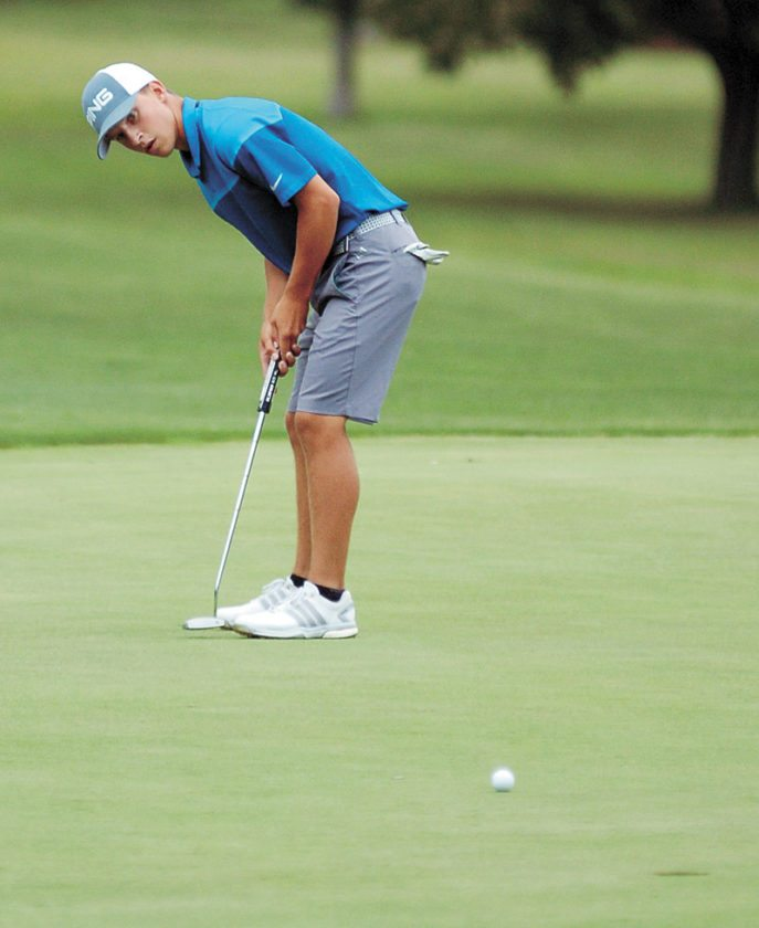 T-R PHOTO BY ROSS THEDE • Marshalltown High School senior-to-be Nate Vance tries for birdie on the 17th green during the final round of the T-R City Golf Tournament on Sunday at the American Legion. Vance finished two strokes out of first place.