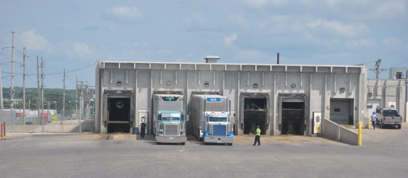 aT-R FILE PHOTO Shown are semis unloading hogs at JBS's Marshalltown plant. The company is Marshalltown's largest employer, and purchases and processes an estimated 5 million hogs annually.