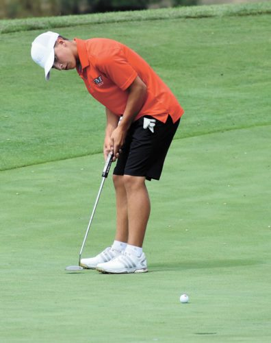 T-R PHOTO BY THORN COMPTON • MHS senior Nate Vance rolls a putt into the cup on the 10th hole of The Legacy Golf Course in the Bobcats' win over Dowling Catholic to open up the 2017 season. Vance carded the low round of the day, shooting a 4-under-par 68 for medalist honors on Thursday in Norwalk.