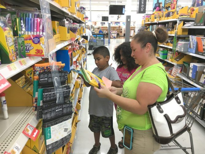Families could be seen moving in and out of school supply sections of stores like Wal Mart in Marshalltown Thursday with the first day of school only a few weeks away. Juanita Valdez was one parent collecting items and looking for sales, and she was joined by her fourth grade twins Maricarmen and José.