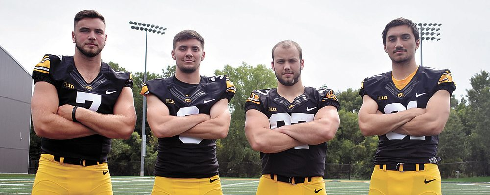 T-R PHOTO BY THORN COMPTON • Marshalltown native Tyler Kluver, second from right, is the only senior on the University of Iowa football team's special team unit. He's joined by, from left, punter Colton Rastetter and placekickers Keith Duncan and Miguel Recinos.