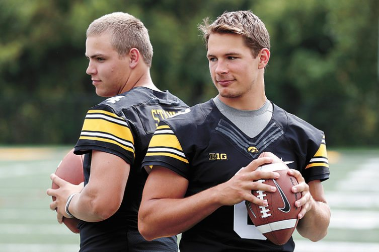AP PHOTO • University of Iowa quarterbacks Nathan Stanley, left, and Tyler Wiegers pose for a photo during the Hawkeyes' media day Aug. 5 in Iowa City.
