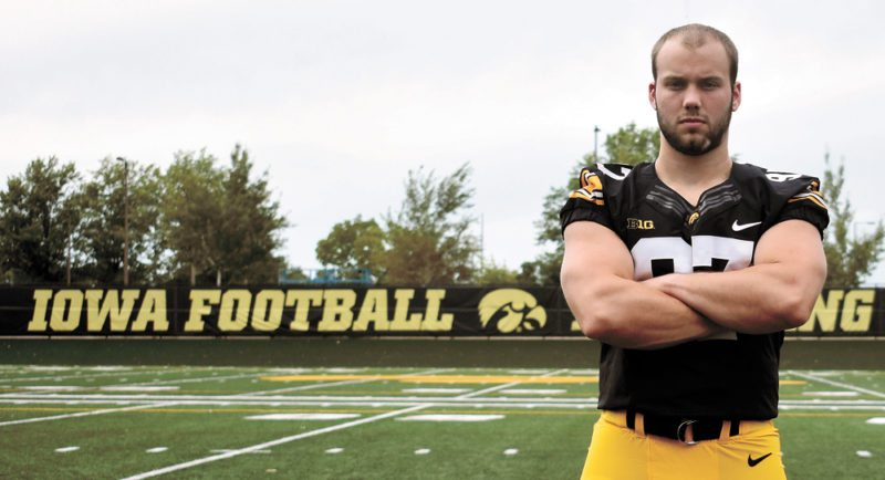 T-R PHOTO BY THORN COMPTON • Tyler Kluver, a 2013 Marshalltown High School graduate, poses for a photograph during the University of Iowa football team's annual media day event Aug. 5 in Iowa City. Kluver, the only senior in the special teams unit, is savoring his last season with the Hawkeyes.