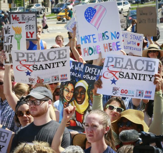 """Protesters listen during a """"Peace and Sanity"""" rally Sunday Aug. 13, 2017, in the Brooklyn borough of New York, during a rally about white supremacy violence in Charlottesville, Va., (AP Photo/Bebeto Matthews)"""
