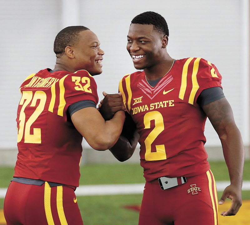AP PHOTO • Iowa State running backs David Montgomery, left, and Mike Warren share a laugh during Iowa State's annual football media day event Aug. 3 in Ames.