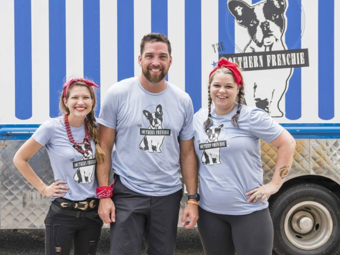 """CONTRIBUTED PHOTO Former Marshalltown resident Donnie Ferneau Jr., center, and his wife Meaghan, left, and sous chef Amanda Ivy, will be contestants on the latest season of """"The Great Food Truck Race,"""" which premieres Sunday at 8 p.m. on the Food Network. The television show, now in its eighth season, has seven teams of food truck novices traveling the South, competing for a grand prize of $50,000. Ferneau's team, The Southern Frenchie, is based in Little Rock, Ark."""