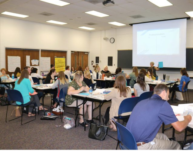 T-R PHOTO BY ADAM SODDERS Woodbury Elementary teacher-librarian Sue Cahill led new teacher orientation for 38 new Marshalltown instructors Tuesday. Professionalism, student-teacher connections and community building were among the topics discussed.