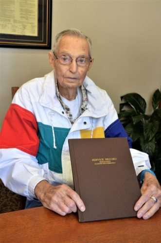 T-R PHOTO BY CHUCK FRIEND Veteran Jack Gaunt, now a resident of Glenwood Place in Marshalltown, holds a booklet of Le Grand area residents who served their country during World War II. Gaunt spent much of his military career servicing aircraft in the areas of Guadalcanal and several islands in the South Pacific.