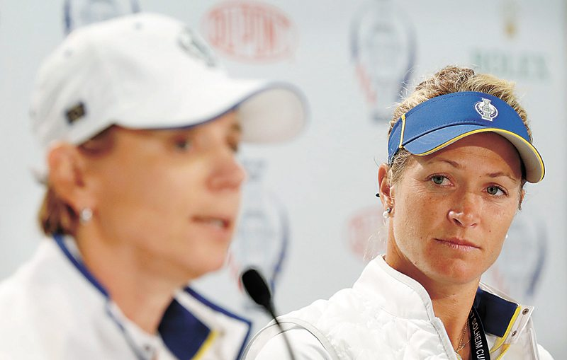 AP PHOTO • Europe's Suzann Pettersen, of Norway, listens as Team Europe captain Annika Sorenstam, left, speaks during a news conference for the Solheim Cup on Wednesday at Des Moines Golf and Country Club in West Des Moines. Pettersen has pulled out of this weekend's event because of a back injury.