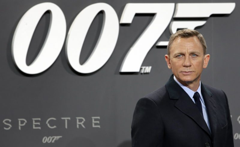 "FILE - This is a Wednesday, Oct. 28, 2015 file photo of actor Daniel Craig poses for the media as he arrives for the German premiere of the James Bond movie 'Spectre' in Berlin, Germany. British actor Daniel Craig announced he returning to cars, cocktails and camera pens to play James Bond in the franchise's next film, due out in 2019.  The 49-year old actor told Stephen Colbert on Tuesday night's ""Late Show"" that it will likely be his last time playing 007, and that he hopes to ""go out on a high note."" (AP Photo/Michael Sohn/File)"