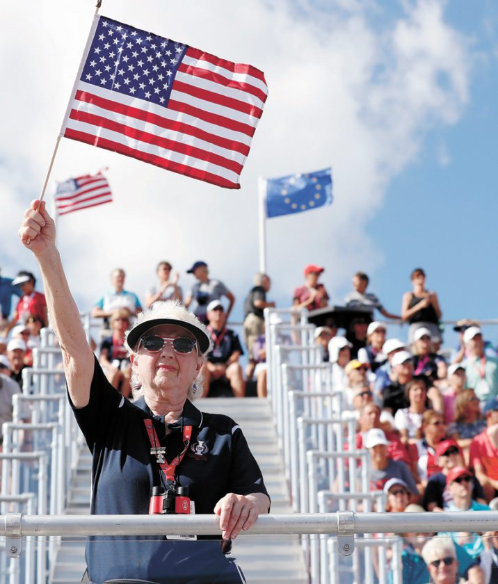 AP PHOTO • A fan cheers during the opening ceremony for the Solheim Cup golf tournament Thursday in West Des Moines.
