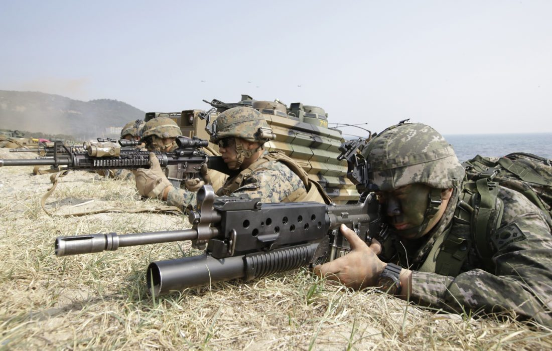"""FILE - In this March 30, 2015, file photo, Marines of South Korea, right and the U.S aim their weapons near amphibious assault vehicles during the U.S.-South Korea joint landing military exercises as a part of the annual joint military exercise Foal Eagle between South Korea and the United States in Pohang, South Korea. America's annual joint military exercises with South Korea always frustrate North Korea. The war games set to begin Monday, Aug. 21, 2017 may hold more potential to provoke than ever, given President Donald Trump's """"fire and fury"""" threats and Pyongyang's as-yet-unpursued plan to launch missiles close to Guam. (AP Photo/Lee Jin-man, File)"""