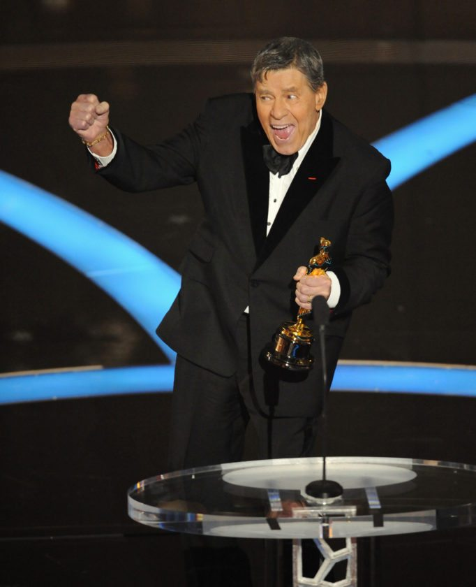 FILE - In this Sunday, Feb. 22, 2009, file photo, Jerry Lewis accepts the Jean Hersholt Humanitarian Award by the Board of Governors of the Academy of Motion Picture Arts and Sciences during the Oscars telecast during the 81st Academy Awards, in the Hollywood section of Los Angeles. Lewis, the comedian and director whose fundraising telethons became as famous as his hit movies, has died. Lewis died Sunday, Aug. 20, 2017, according to his publicist. He was 91. (AP Photo/Mark J. Terrill, File)