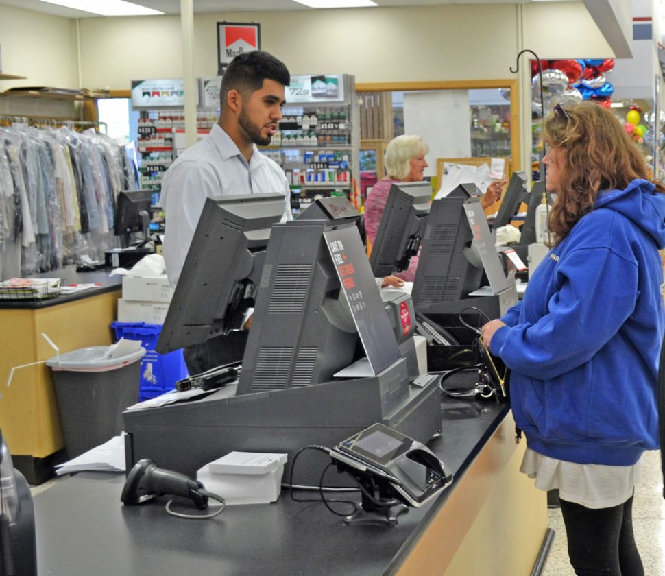 T-R PHOTO BY SARA JORDAN-HEINTZ Powerball fever has swept through Marshalltown, with tonight's estimated Powerball of $700 million. Here Sherry Menter purchases a Powerball ticket at the Marshalltown Hy-Vee, from employee Adan Rodriguez.