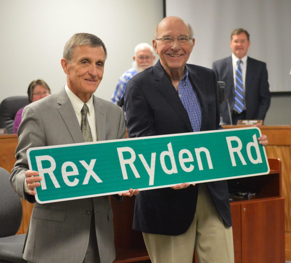 T-R FILE PHOTO  Marshalltown Mayor Jim Lowrance, left, presented Attorney Rex Ryden with a street sign bearing his name at the June 13, 2016 city council meeting. Ryden received a standing ovation from city council. city staff, and attendees. The sign was later placed in the Marshalltown Industrial Park, and was given as a token of appreciation for Ryden's many years of volunteer contributions to MIP and numerous other community organizations. Ryden had previously retired earlier in the year after many years as partner at the Cartwright, Druker & Ryden law firm. He died Aug. 22.