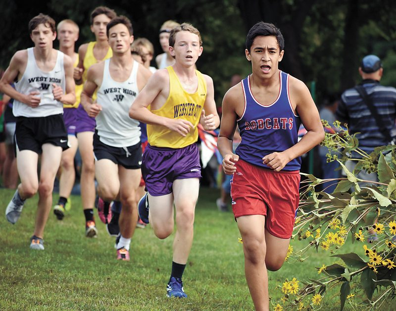 T-R PHOTO BY THORN COMPTON • Marshalltown's Zach Bitker, right, leads a pack of runners along the Marshalltown Community College course on Thursday. Bitker placed 43rd to score for the Bobcats, finishing in a time of 20 minutes, 7.9 seconds.