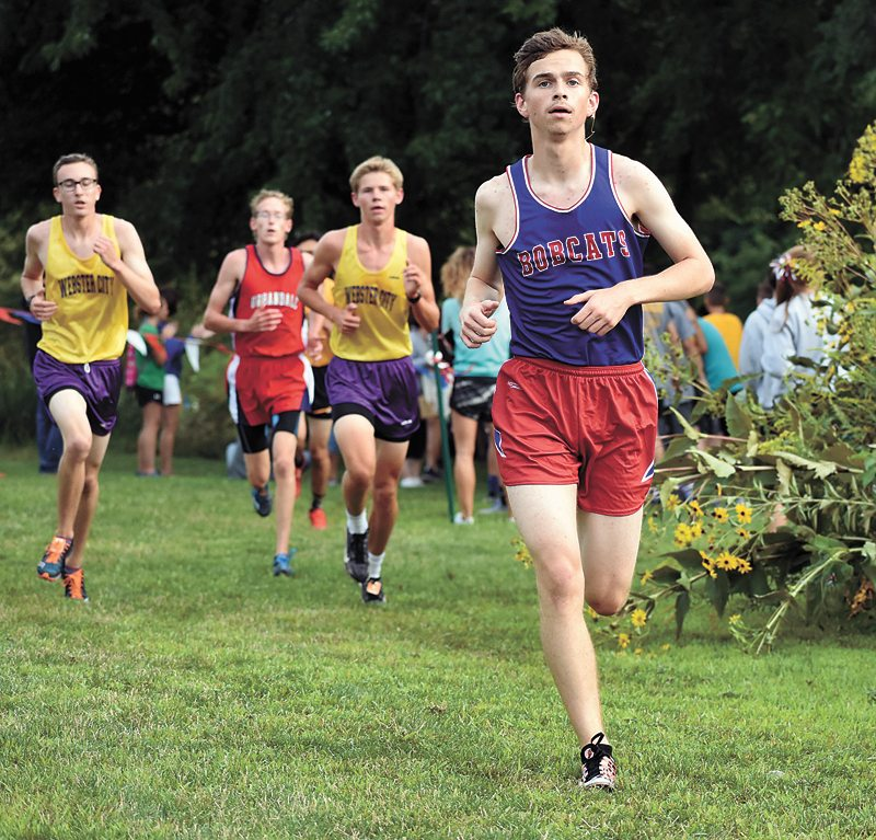 T-R PHOTO BY THORN COMPTON • Marshalltown senior Luke Pedersen makes his way through the course at Marshalltown Community College during the MHS Early Bird Cross Country Meet on Thursday. Pedersen was the highest finisher from the area, taking 13th place for the Bobcats.