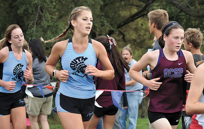 T-R PHOTO BY THORN COMPTON • Grundy Center/Gladbrook-Reinbeck's Lily Ehlers, right, leads South Tama County runners Callie Frakes, center, and Jessica Musgrave along the MCC course on Thursday in Marshalltown.