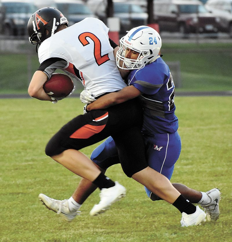 T-R PHOTO BY THORN COMPTON • Marshalltown junior Alex Rockingham (24) takes down Ames junior Will Krapfl during the second quarter of the Bobcats' loss to the Little Cyclones at home on Friday night.