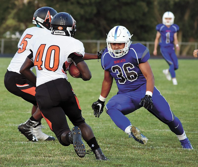 T-R PHOTO BY THORN COMPTON • Marshalltown senior Marco Ordaz (36) bears down on Martell Davis (40) as he returns the opening kickoff for Ames in the Little Cyclones' 43-13 defeat of the Bobcats to open the season on Friday.