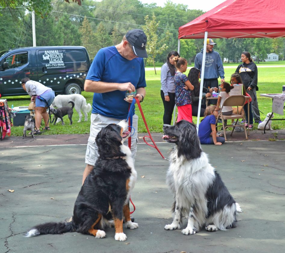The ARL's first annual Bark in the Park was held Saturday at Riverview Park, offering dogs and their owners various services, resources and educational opportunities. Pictured is Jeff Gethmann and his two dogs, Aspen, left, and Summit, enjoying some treats after the 5K walk/run.