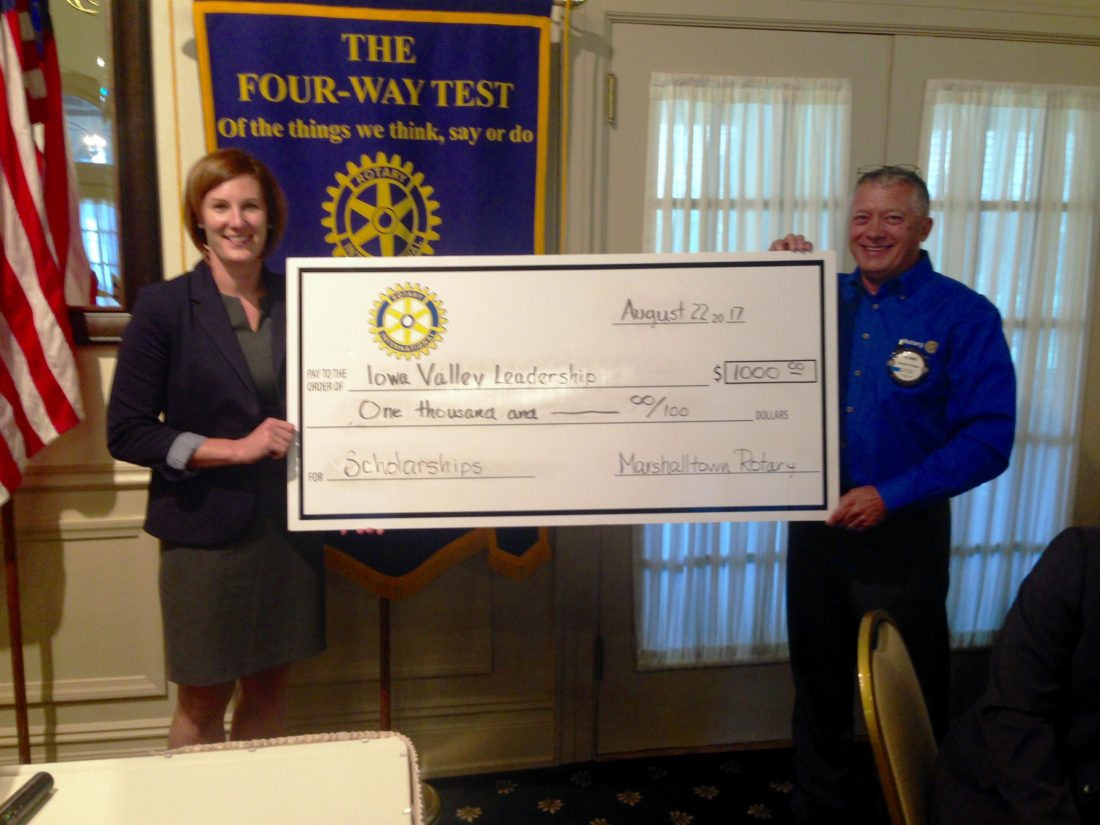 Lynn Olberding accepts a donation from Marshalltown Rotary to support a scholarship for the upcoming Iowa Valley Leadership classes