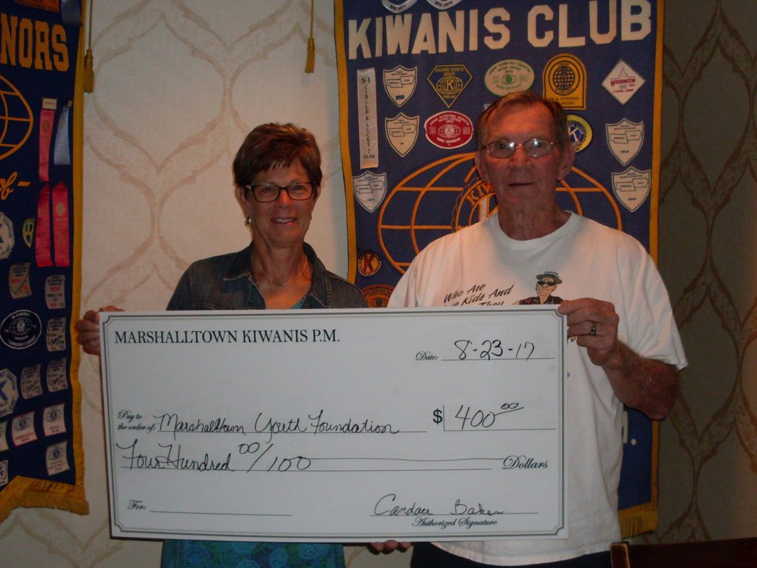 iwanis P.M. President Kenny Lamb presented a check in the amount of $400 to Terry Gray in support of the Marshalltown Youth Foundation's ongoing work with local children.