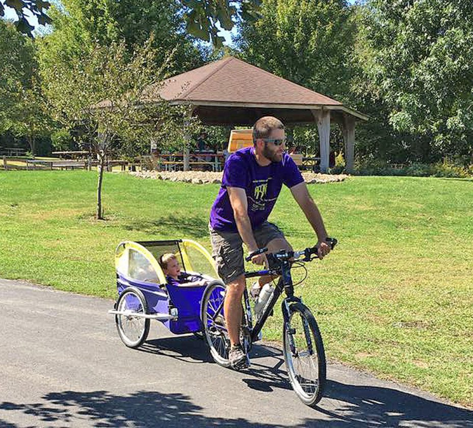 "CONTRIBUTED PHOTO A dad gives his young child a ride at GrimesFarm during the 2016 ""Pathways to Recovery"" bike/walk. The Substance Abuse Unit for Central Iowa, Center Associates and Primary Health are cosponsoring this year's event Sept. 17. Contact SATUCI to register."