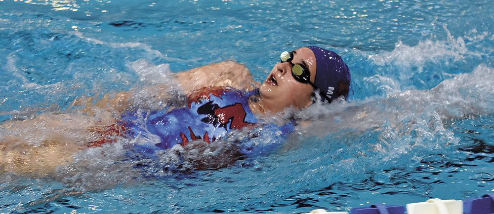 T-R PHOTO BY THORN COMPTON • Marshalltown freshman Emily Manis competes in the 100-yard backstroke during Thursday's dual meet against Des Moines East, where she would go on to take third. The Bobcats beat the Scarlets 116-67 in the meet.