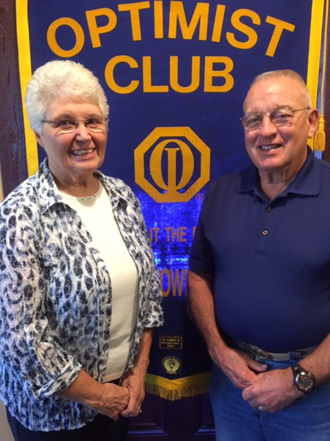 "CONTRIBUTED PHOTO Morning Optimist Club member Doug Noid, right, welcomes guest speaker Rita Smith, who explained the process of the annual ""Stuff the Bus"" school supply give-away at a recent club meeting. Smith is one of the 54 volunteers who assist with receiving, sorting, distributing and shopping for the hundreds of backpacks full of supplies that are given to qualifying families prior to the beginning of the school year."