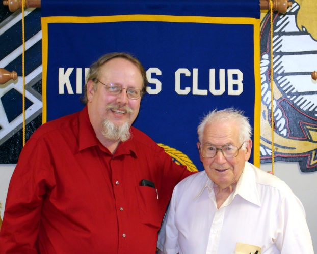 "CONTRIBUTED PHOTO Fire Department Chaplain David Shearer, left, is welcomed to Kiwanis ""Noon"" by member Harold Cline as he presented a program on the history of the department."