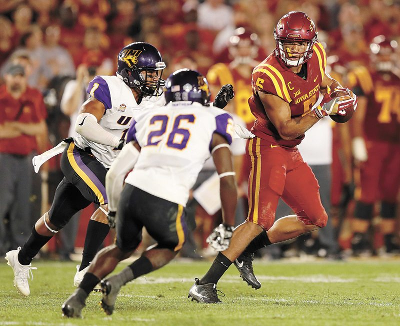 AP PHOTO • Iowa State wide receiver Allen Lazard, right, tries to avoid Northern Iowa defenders Elijah Campbell, left, and Isaiah Nimmers (26) after making a reception during the second half of Saturday's college football game in Ames. Iowa State won 42-24.