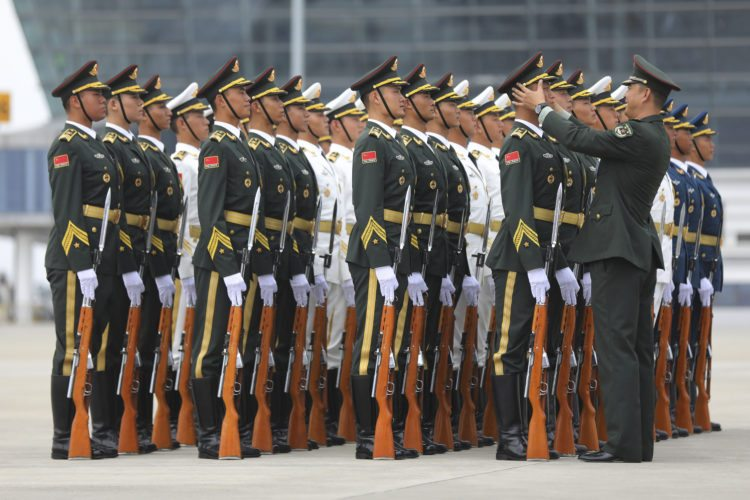 Chinese People's Liberation Army honor guard prepare for the arrival of Brazilian President Michel Temer at Xiamen Gaoqi International Airport to attend the upcoming BRICS Summit in Xiamen, China's Fujian province, Sunday, Sept. 3, 2017.   (Wu Hong/Pool Photo via AP)
