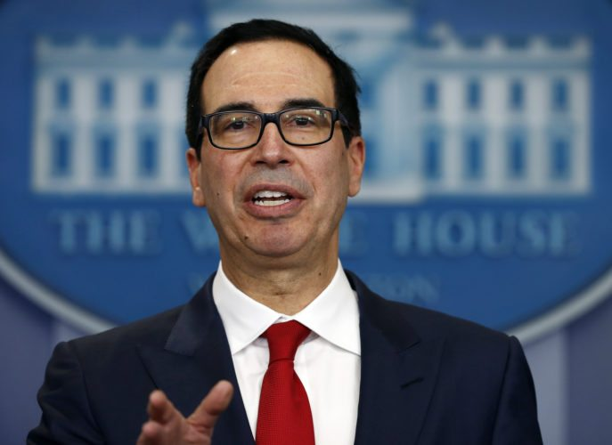 "FILE - In this Friday, Aug. 25, 2017, file photo, Treasury Secretary Steven Mnuchin speaks during a news briefing at the White House in Washington. Mnuchin is calling on Congress to combine a $7.9 billion disaster relief package for Hurricane Harvey with a contentious increase in the nation's debt limit. He says it's time to ""put politics aside"" so storm victims can get the help they need."" Trump plans to meet with congressional leaders from both parties this week. (AP Photo/Carolyn Kaster, File)"