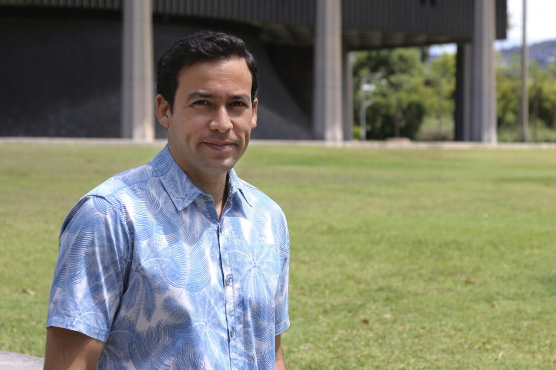 In this Aug. 17, 2017, photo, Hawaii state Rep. Chris Lee poses in front of the capitol. Hawaii is considering doling out universal basic income, where everyone gets a chunk of money with no strings attached, and Lee is a supporter. The idea has attracted supporters across the U.S. and elsewhere as technology leaders, elected officials and economists debate what our lives will look like when robots and machines take over more and more jobs that human beings have held for decades. (AP Photo/Cathy Bussewitz)