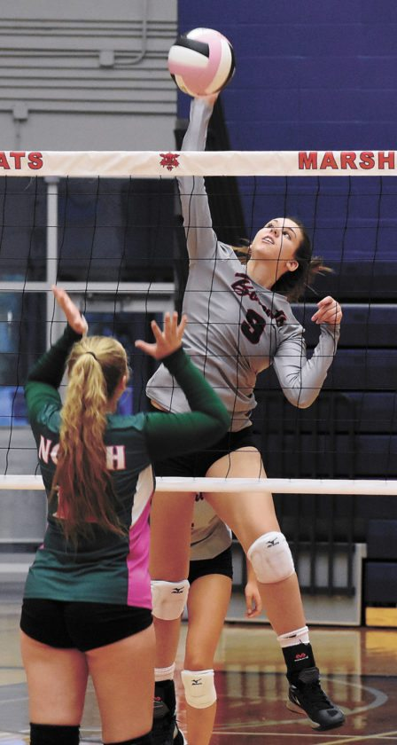 T-R PHOTO BY THORN COMPTON • Marshalltown senior Molly Bach eyes a kill during the Bobcats' three-set sweep of Des Moines North at home on Tuesday night.