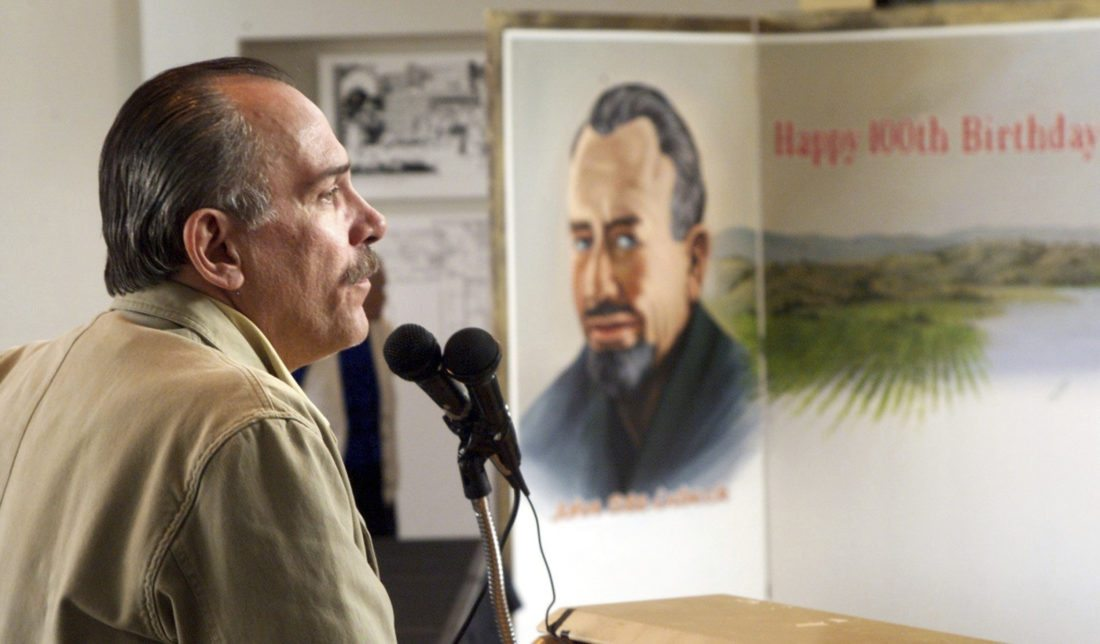 """FILE - In this Feb. 27, 2002 file photo, Thomas Steinbeck, son of author John Steinbeck, speaks to a crowd at the National Steinbeck Center in Salinas, Calif., to celebrate what would have been his father's 100th birthday. He died on Aug. 11, 2016 at age 72. Waverly Scott Kaffaga, step-daughter of John Steinbeck, told jurors in federal court Tuesday, Aug. 29, 2017 that film remakes of """"The Grapes of Wrath"""" and """"East of Eden"""" fell apart because Thomas his and widow Gail Steinbeck interfered with the projects. She told jurors in Los Angeles federal court that long-running litigation has prevented her from making the most of Steinbeck's copyright. (Richard Green/The Californian, File)"""