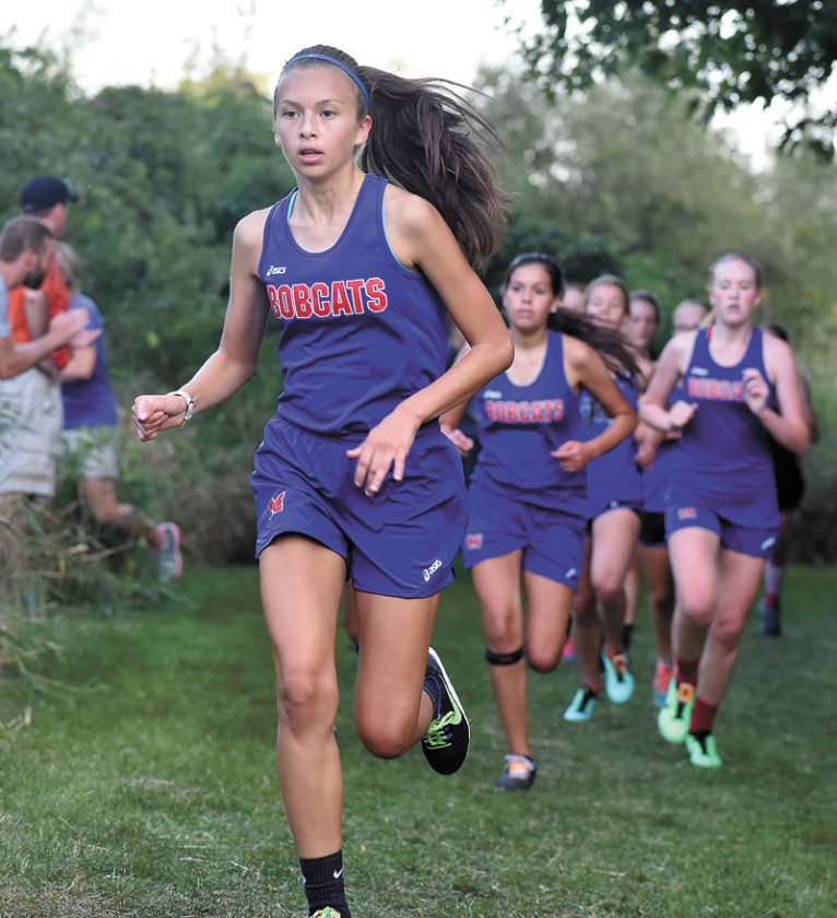 T-R PHOTO BY THORN COMPTON • Marshalltown's Aida Almanza leads a pack of Bobcat runners during the 44th annual Bobcat Invite on Thursday at MCC. Almanza placed 85th in a time of 23 minutes, 4 seconds.