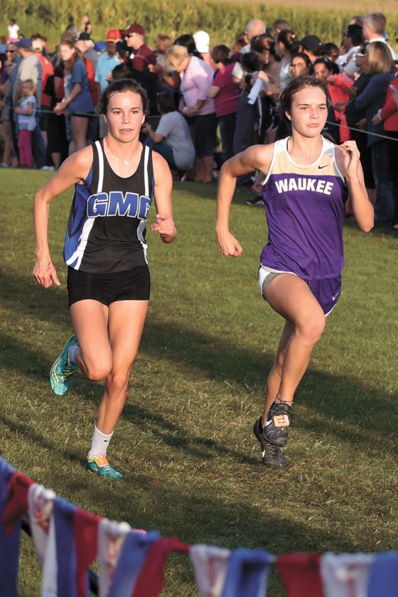 T-R PHOTO BY THORN COMPTON • GMG's Kyla Wilkening, left, and Waukee's Isabelle Schaffer sprint toward the finish of Thursday's Bobcat Invite in Marshalltown. Wilkening placed 28th in a time of 20 minutes, 9 seconds.