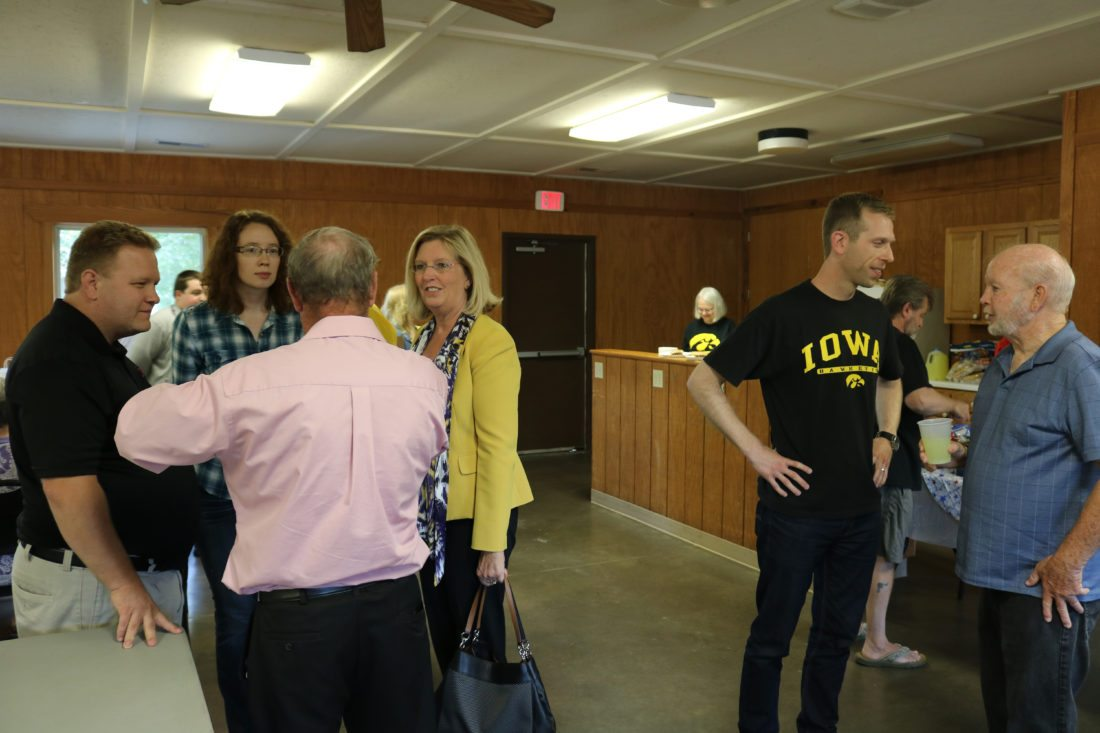 Marshall County Democrats welcomed gubernatorial candidate, Dr. Andy McGuire (yellow jacket) and First District Congressional candidate Thomas Heckroth (Iowa Hawkeye T-shirt) during a party event Friday in Marshalltown.