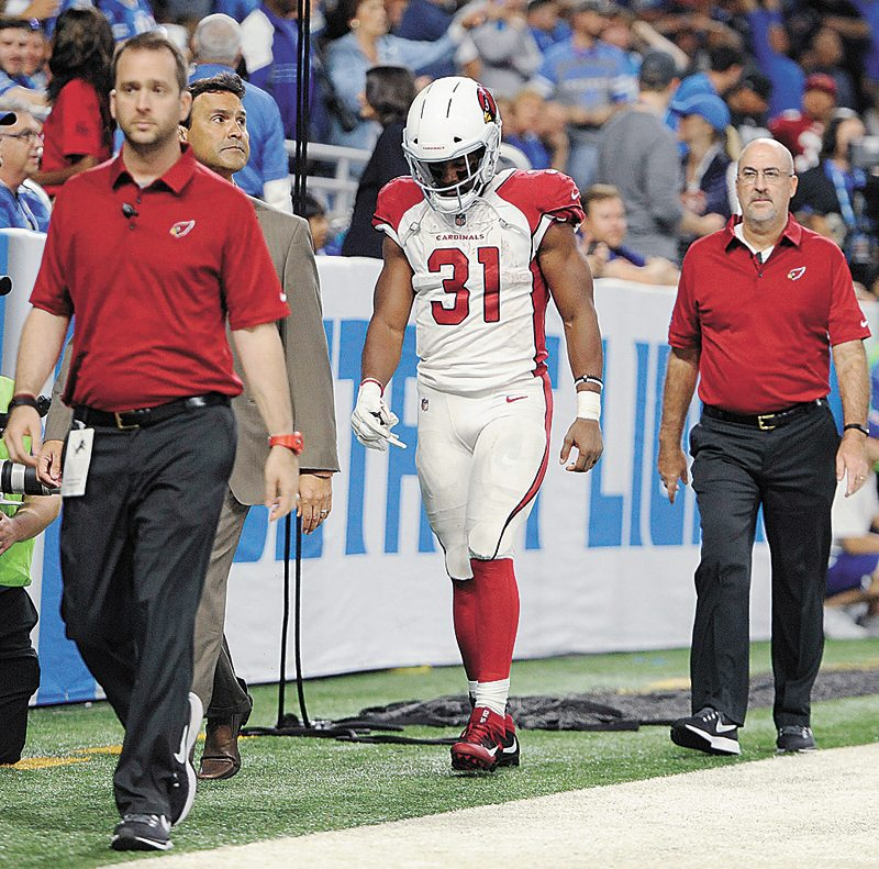 AP PHOTO • Arizona Cardinals running back David Johnson (31) walks off the field with medical staff for X-rays during Sunday's NFL game against the Detroit Lions in Detroit.