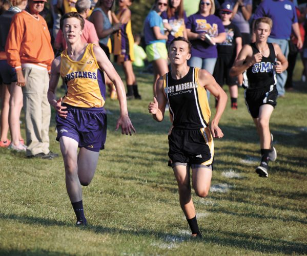 T-R PHOTO BY THORN COMPTON • East Marshall junior Cade Curphy (left) and West Marshall senior Ron Maxey (center) compete for ninth place at the South Tama County Invite on Saturday while GMG sophomore Jackson Edens finishes just behind them in 11th.