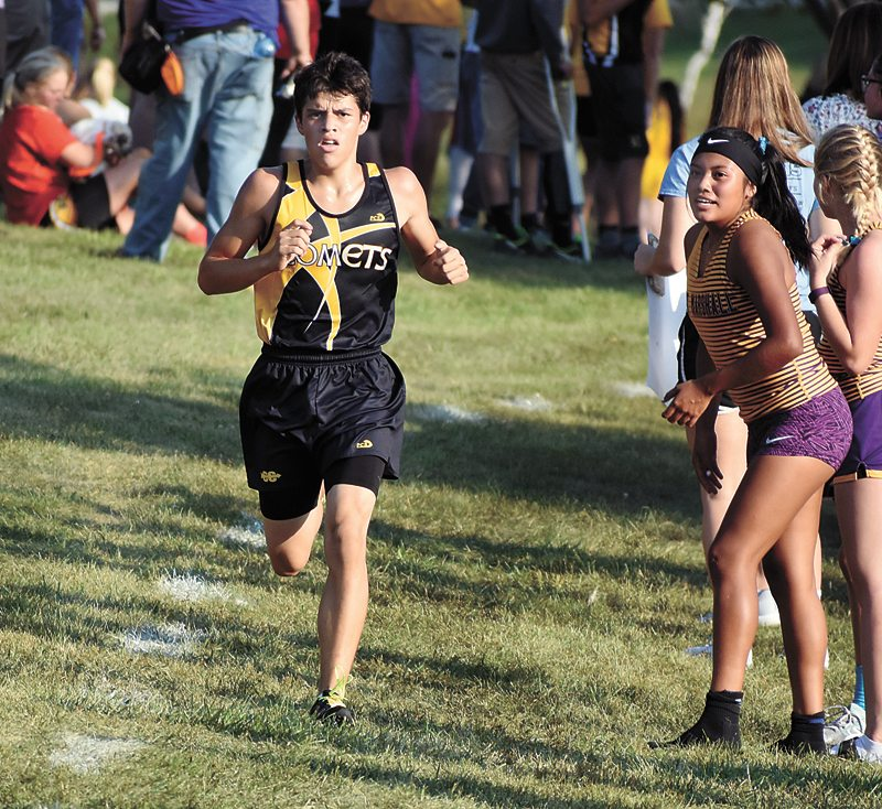 T-R PHOTO BY THORN COMPTON • BCLUW junior Neifer Ralston approaches the finish line at the South Tama County Invitational on Monday where he would finish sixth in a race that Comets head coach Donna Fiscus called one of the most impressive from her team on the day.