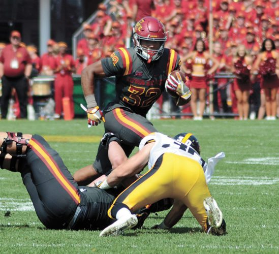 T-R PHOTO BY ROSS THEDE • Iowa State running back David Montgomery (32) looks for room to run around Iowa's Jake Gervase during Saturday's Iowa Corn Cy-Hawk Series game in Ames.