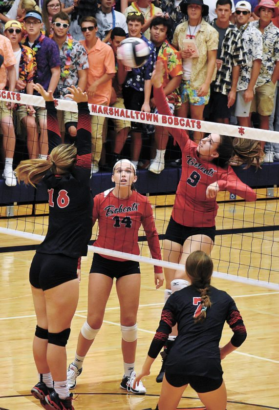 T-R PHOTO BY THORN COMPTON • Marshalltown senior Molly Bach (9) shoots a spike toward Fort Dodge's Loghen Schnetzer (18) and Brooke Erickson (7) during the Bobcats' three-set sweep of the Dodgers.