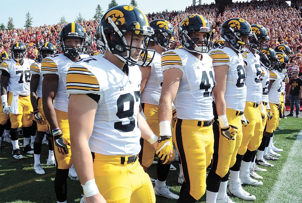 T-R PHOTO BY  ROSS THEDE • Marshalltown native Tyler Kluver (97) and the University of Iowa football team line up before entering the field for Saturday's Cy-Hawk game between the Hawkeyes and Iowa State Cyclones at Jack Trice Stadium in Ames.