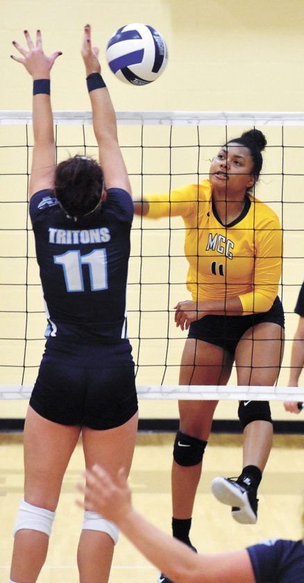 T-R PHOTO BY THORN COMPTON • Marshalltown Community College outside hitter Jesenia Colbert slams a spike past Iowa Central's Abby Lohrmann during the Triton's 3-1 victory over the Tigers on Wednesday night.