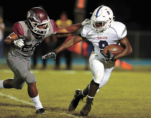 PHOTO BY MATTHEW PUTNEY/THE COURIER • Marshalltown running back Kabba Pins (9) tries to turn the corner on Waterloo West's Zacc Sanders in the second half of Friday's game in Waterloo. The host Wahawks won 56-14.