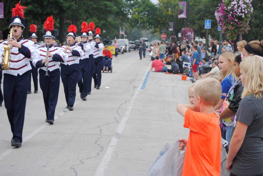 T-R FILE PHOTO Children watch intently as the Marshalltown High School Bobcat Band marches on Main Street during last year's Oktemberfest parade. Each year,  thousands of spectators of all ages and from various Central Iowa locales line the route in anticipation of the 10 a.m. Saturday start.